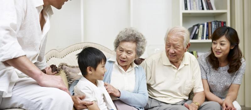 20636318 – three-generation asian family talking in living room